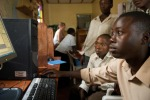 Secondary school children in Uganda use a computer for the first time